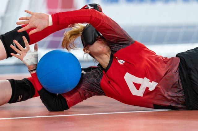 Meghan Mahon of Canada collides with the feet of her team mate Amy Burk as the goalball competition started