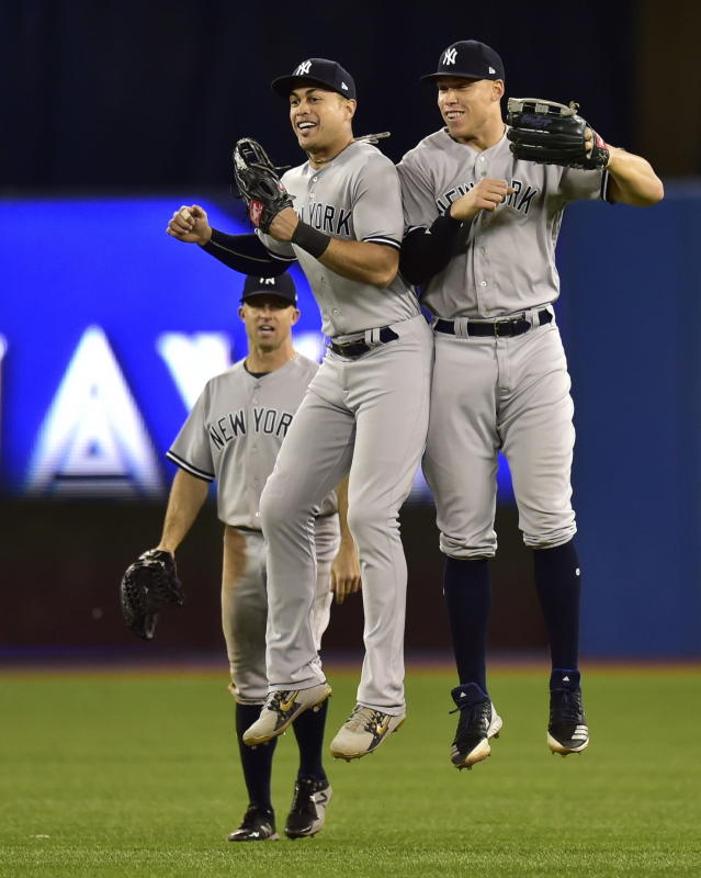 New York Yankees right fielder Aaron Judge, right, and left fielder Giancarlo Stanton celebrate after the Yankees defeated the Toronto Blue Jays 3-0 in 13 innings in a baseball game Wednesday, June 6, 2018, in Toronto. (Frank Gunn/The Canadian Press via AP)
