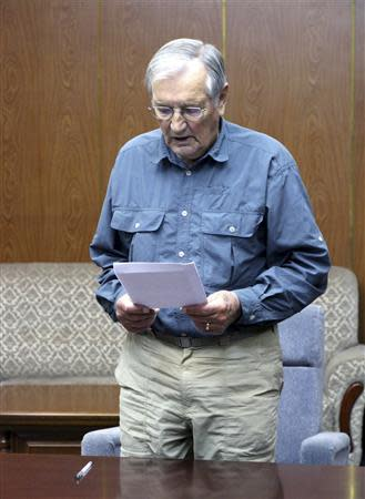 """U.S. citizen Merrill E. Newman reads from a piece of paper at an undisclosed location in this undated photo released by North Korea's Korean Central News Agency (KCNA) in Pyongyang on November 30, 2013. North Korea said on Saturday it had arrested Newman for """"hostile acts"""" against the state and accused him of being """"a criminal"""" who was involved in the killing of civilians during the 1950-53 Korean War. REUTERS/KCNA"""