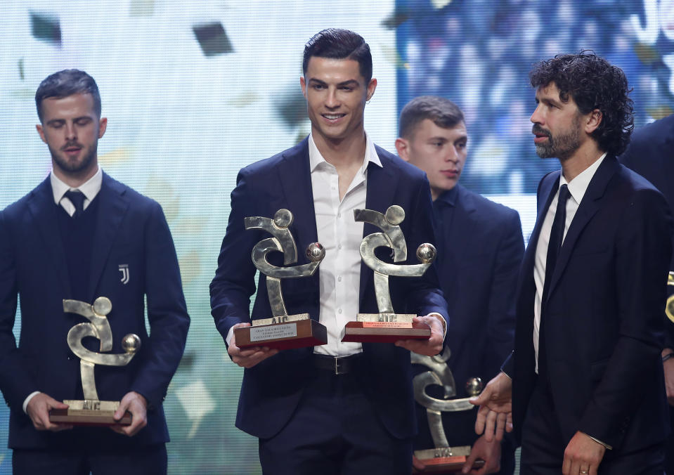 Juventus' Cristiano Ronaldo poses with the trophy for best Italian Serie A player, during the Gran Gala' soccer awards ceremony, in Milan, Italy, Monday, Dec. 2, 2019. (AP Photo/Antonio Calanni)