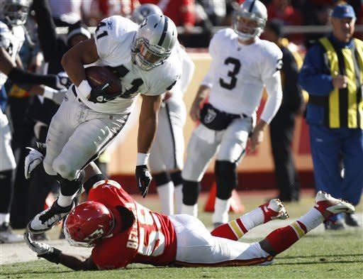 Oakland Raiders fullback Manase Tonga (41) is tackled by Kansas City Chiefs inside linebacker Jovan Belcher (59) during the first half of an NFL football game at Arrowhead Stadium in Kansas City, Mo., Saturday, Dec. 24, 2011. (AP Photo/Ed Zurga)