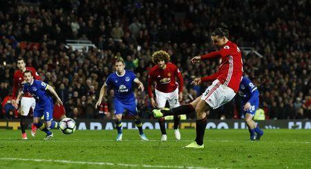 Britain Football Soccer - Manchester United v Everton - Premier League - Old Trafford - 4/4/17 Manchester United's Zlatan Ibrahimovic scores their first goal from the penalty spot Action Images via Reuters / Jason Cairnduff Livepic