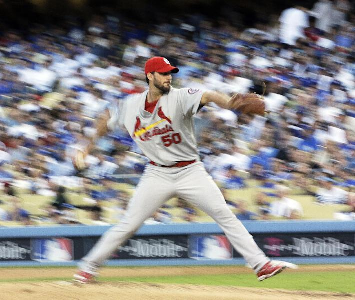 St. Louis Cardinals starting pitcher Adam Wainwright works during the third inning of Game 3 of the National League baseball championship series against the Los Angeles Dodgers, Monday, Oct. 14, 2013, in Los Angeles. (AP Photo/David J. Phillip)