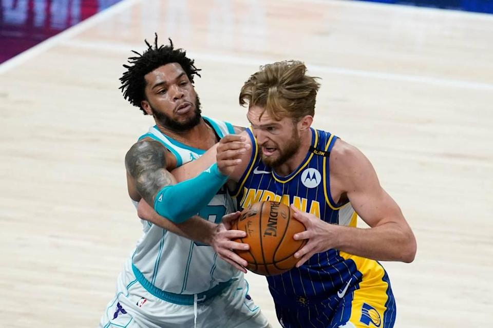 Indiana's Domantas Sabonis,right, goes to the basket against Charlotte's Miles Bridges (0) Tuesday in an NBA play-in tournament game in Indianapolis. Sabonis had 14 points, 21 rebounds and nine assists in the Pacers' win.