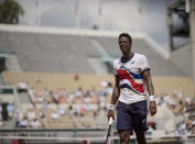 Gael Monfils of France grimaces as he looks towards the umpire as he plays against Sweden's Mikael Ymer during their second round match on day 5, of the French Open tennis tournament at Roland Garros in Paris, France, Thursday, June 3, 2021. (AP Photo/Christophe Ena)