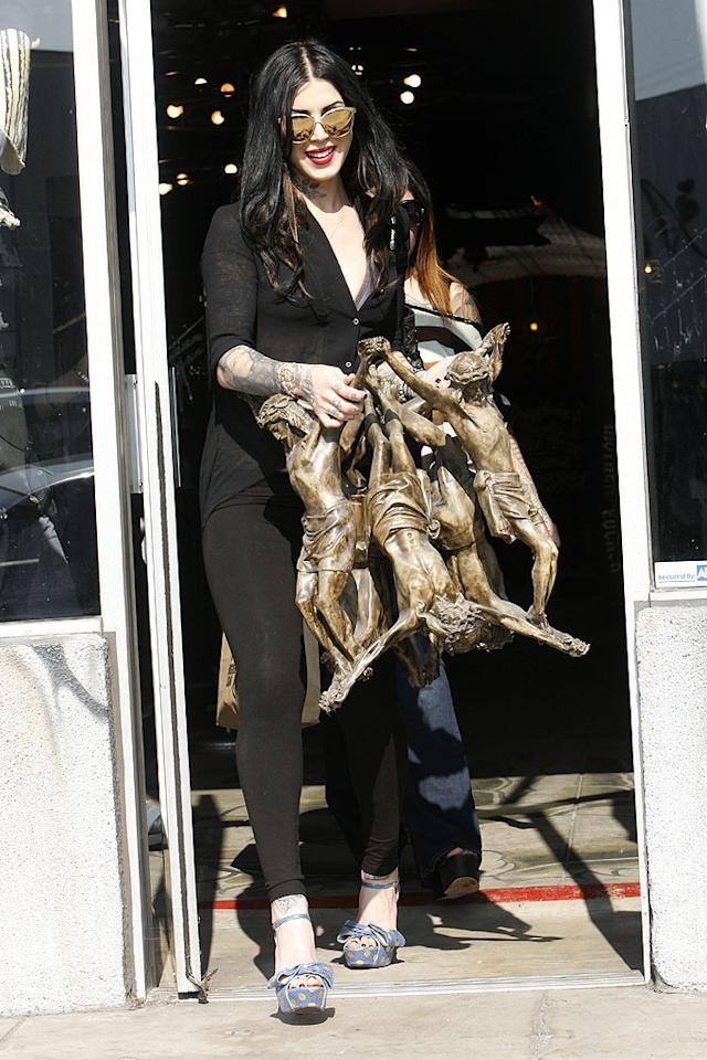 """""""LA Ink"""" star Kat Von D picked up a very unusual item while shopping in West Hollywood on Thursday: a sculpture of the Crucifixion featuring multiple Jesus figures. After loading her art piece, Jesse James' ex sped off in her Bentley convertible. (2/2/2012)"""