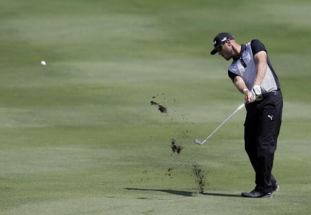 Graham DeLaet hits off of the 16th fairway during the second round of the Byron Nelson Championship golf tournament, Friday, May 16, 2014, in Irving, Texas. (AP Photo/Tony Gutierrez)