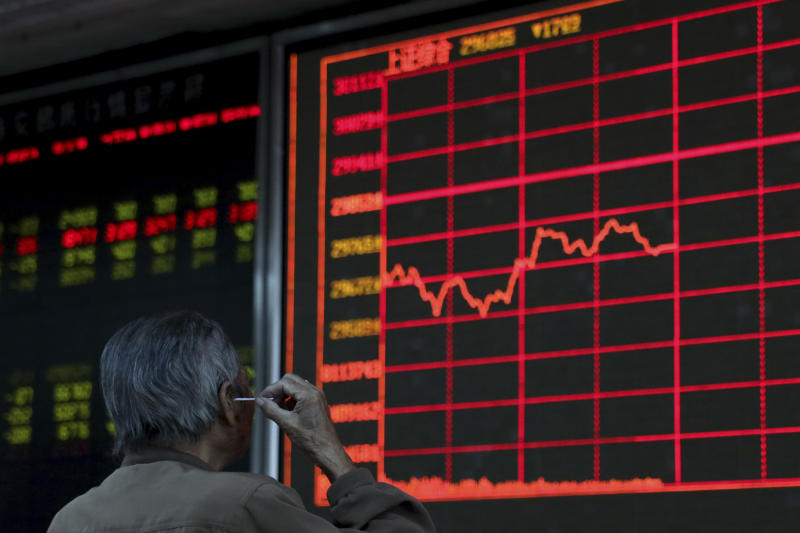 An investor digs his ear while monitoring stock prices at a brokerage in Beijing on Wednesday, Sept. 25, 2019. Stocks skidded in Asia on Wednesday after Democrats in the U.S. House of Representatives said they were considered launching an impeachment probe of President Donald Trump. (AP Photo/Ng Han Guan)