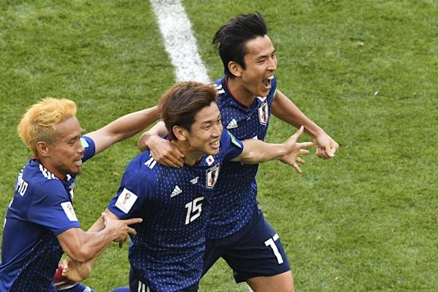 Japan forward Yuya Osako (centre) celebrates after scoring the winning goal against Colombia (AFP Photo/Mladen ANTONOV)