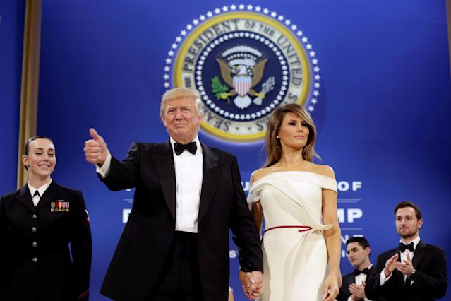 President Trump salutes with first lady Melania Trump at the Armed Services Ball in Washington, Jan. 20, 2017. (Photo: Yuri Gripas/Reuters)