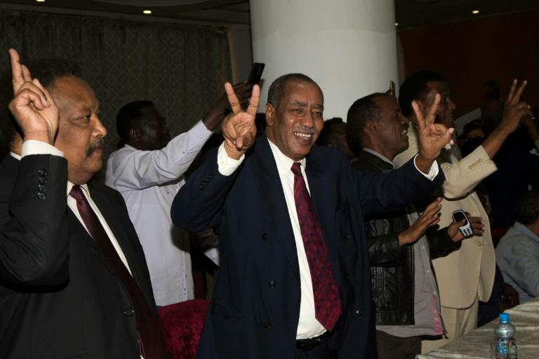 Delegation members of Sudan's transitional government react after two-week long peace talks with rebels in Juba in October