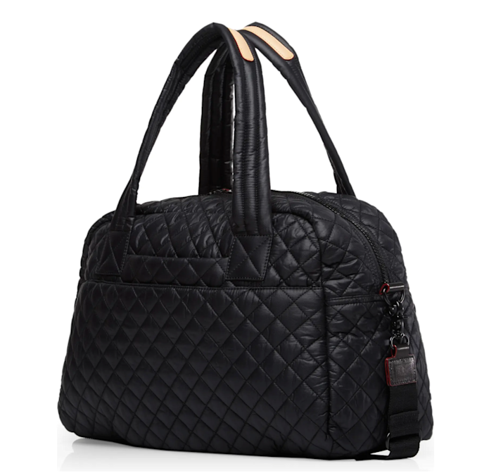 """<h3>MZ Wallace Jimmy Travel Bag</h3><br>The infamous brand's quilted gym-bags are pricey but worth it. This larger, weekender-sized style is durable and deceivingly roomy — with multiple interior compartments and a removable zip-up clutch for storing accessories. <br><br><em>Shop </em><a href=""""https://www.nordstrom.com/brands/mz-wallace--6813"""" rel=""""nofollow noopener"""" target=""""_blank"""" data-ylk=""""slk:MZ Wallace"""" class=""""link rapid-noclick-resp""""><strong><em>MZ Wallace</em></strong></a><br><br><strong>MZ WALLACE</strong> Jimmy Travel Bag, $, available at <a href=""""https://go.skimresources.com/?id=30283X879131&url=https%3A%2F%2Fwww.nordstrom.com%2Fs%2Fmz-wallace-jimmy-travel-bag%2F5223203"""" rel=""""nofollow noopener"""" target=""""_blank"""" data-ylk=""""slk:Nordstrom"""" class=""""link rapid-noclick-resp"""">Nordstrom</a>"""
