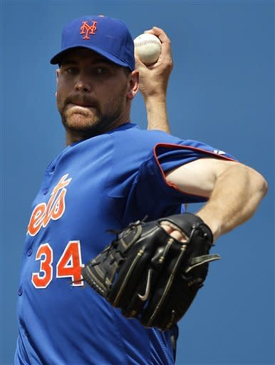 New York Mets starting pitcher Mike Pelfrey warms up between innings during a spring training baseball game against the New York Yankees in Port St. Lucie, Fla., Tuesday, April 3, 2012. (AP Photo/Patrick Semansky)