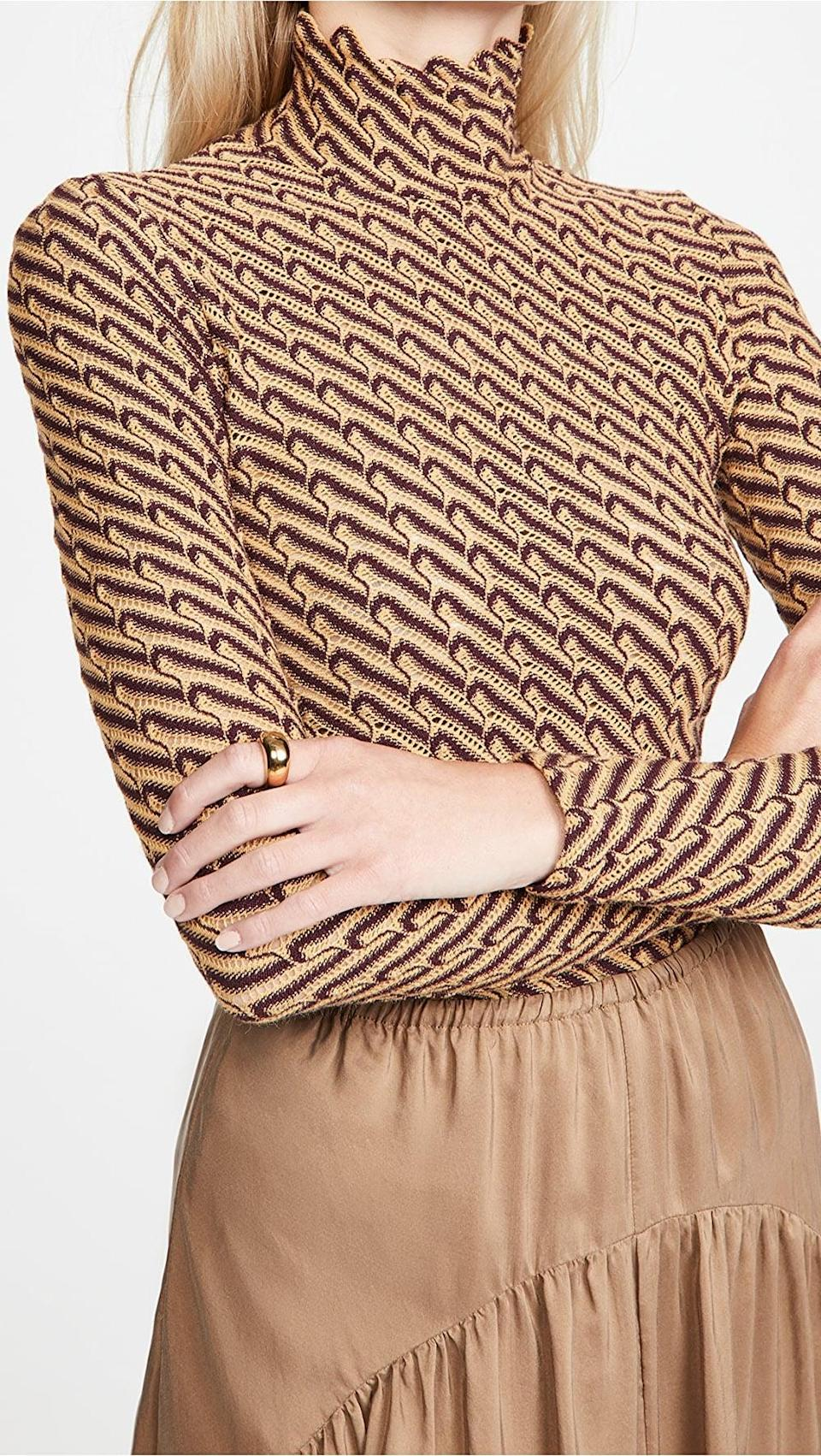 <p>Take a cue from the brand's styling and wear this <span>Beaufille Mena Turtleneck Top</span> ($333, originally $475) with a skirt of a similar color palette.</p>