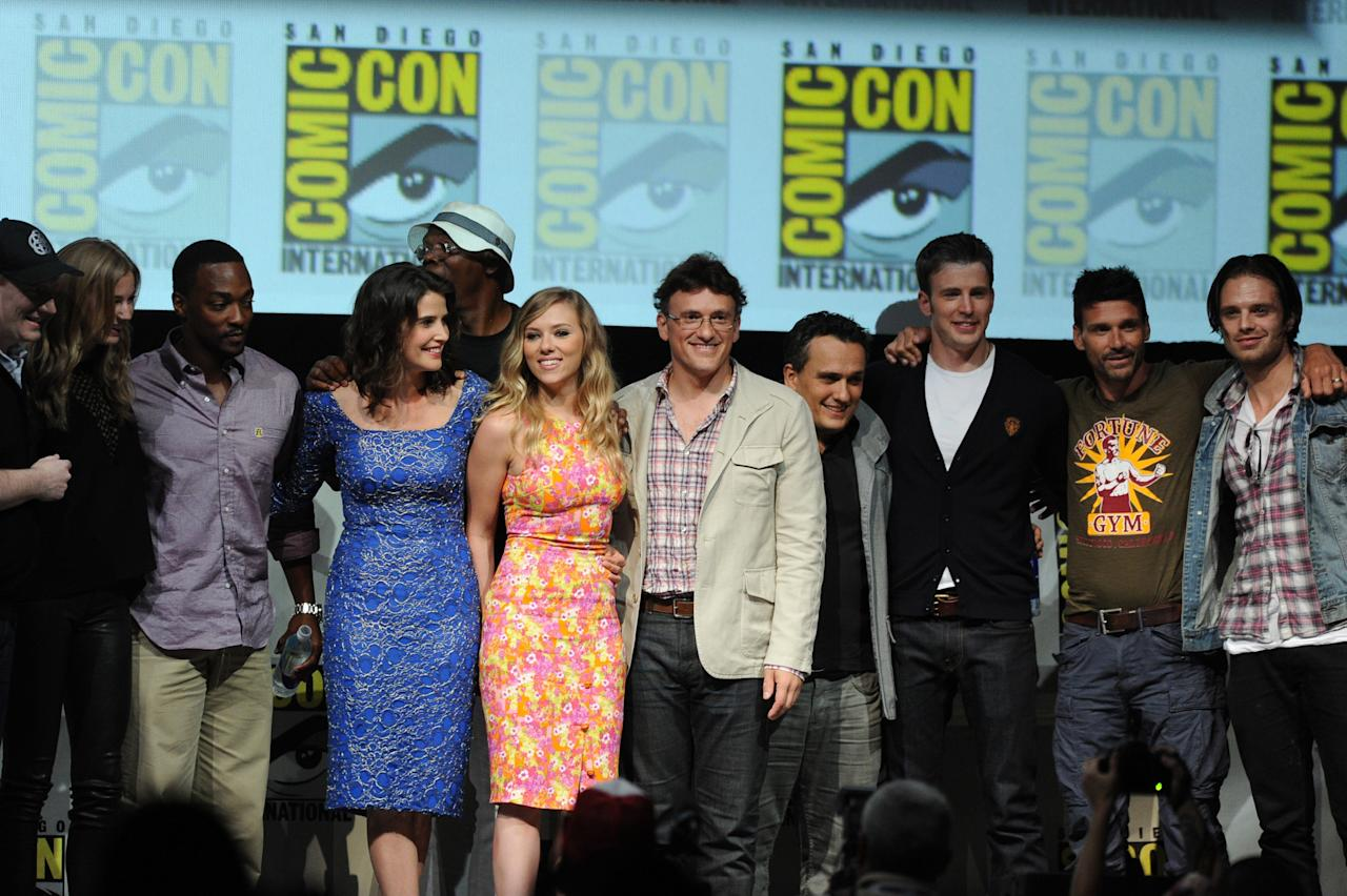 "SAN DIEGO, CA - JULY 20: The cast and crew of ""Captain America: The Winter Soldier"" speaks onstage during Comic-Con International 2013 at San Diego Convention Center on July 20, 2013 in San Diego, California. (Photo by Kevin Winter/Getty Images)"