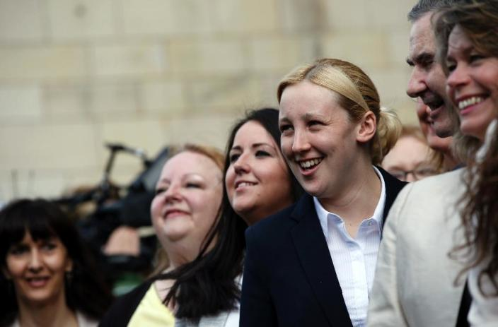 Mhairi Black (R), a newly-elected Scottish National Party (SNP) member of parliament (MP) stands with colleagues during a photocall outside the Houses of Parliament in London on May 11, 2015 (AFP Photo/Adrian Dennis)