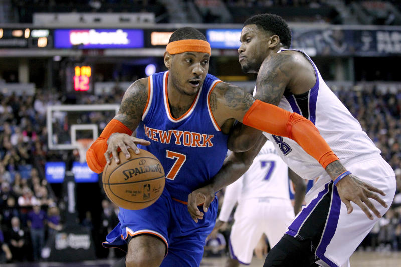 Dec 27, 2014; Sacramento, CA, USA; New York Knicks forward Carmelo Anthony (7) dribbles the ball around Sacramento Kings forward Rudy Gay (8) in the first quarter at Sleep Train Arena. Mandatory Credit: Cary Edmondson-USA TODAY Sports