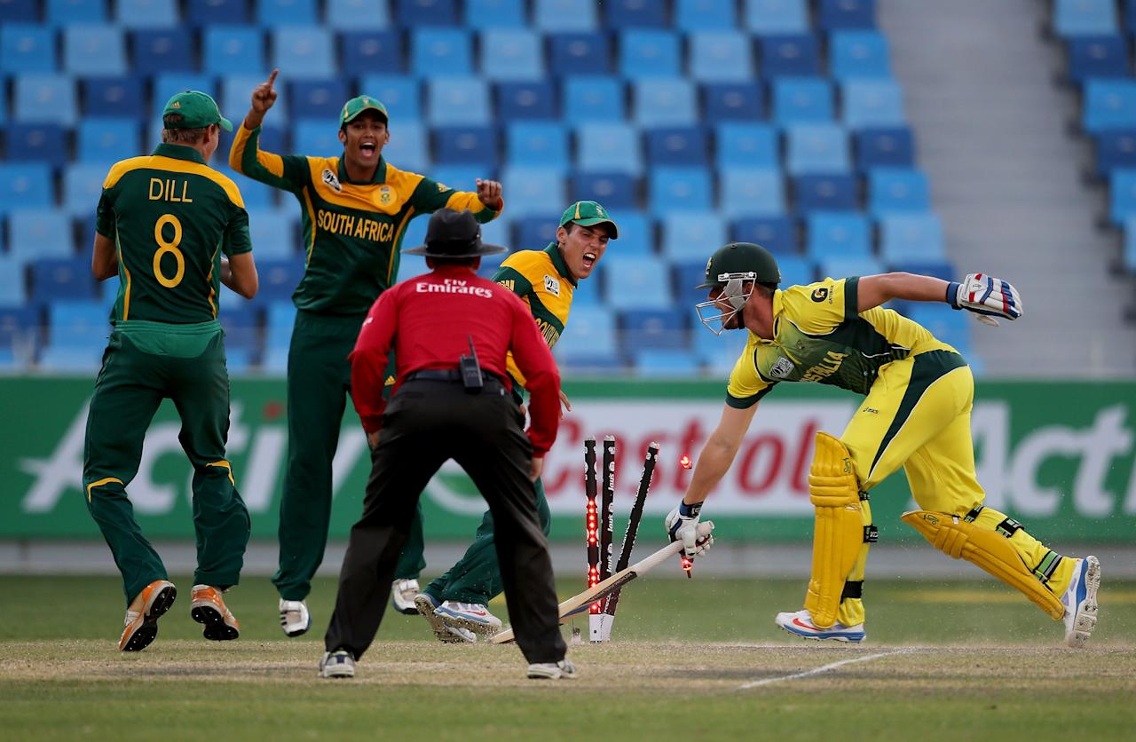 DUBAI, UNITED ARAB EMIRATES - FEBRUARY 26:  Players of South Africa celebrate after dismissing Ben McDermott of Australia during the ICC U19 Cricket World Cup 2014 Semi Final match between South Africa and Australia at the Dubai Sports City Cricket Stadium on February 26, 2014 in Dubai, United Arab Emirates.  (Photo by Francois Nel - IDI/IDI via Getty Images)