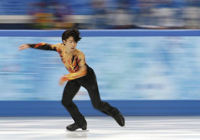 Tatsuki Machida of Japan competes in the men's free skate figure skating final at the Iceberg Skating Palace during the 2014 Winter Olympics, Friday, Feb. 14, 2014, in Sochi, Russia