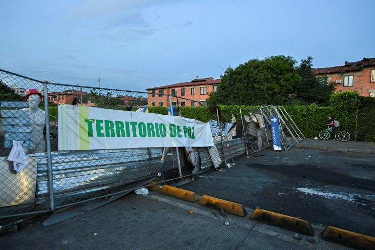 """A banner declaring a """"Peaceful Territory"""" is seen at a roadblock manned by anti-government protesters in Cali, Colombia"""