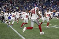 Teammates rush to congratulate New York Giants wide receiver Alonzo Russell (84) after he caught a touchdown to win an NFL preseason football game against the New England Patriots, Thursday, Aug. 29, 2019, in Foxborough, Mass. (AP Photo/Elise Amendola)