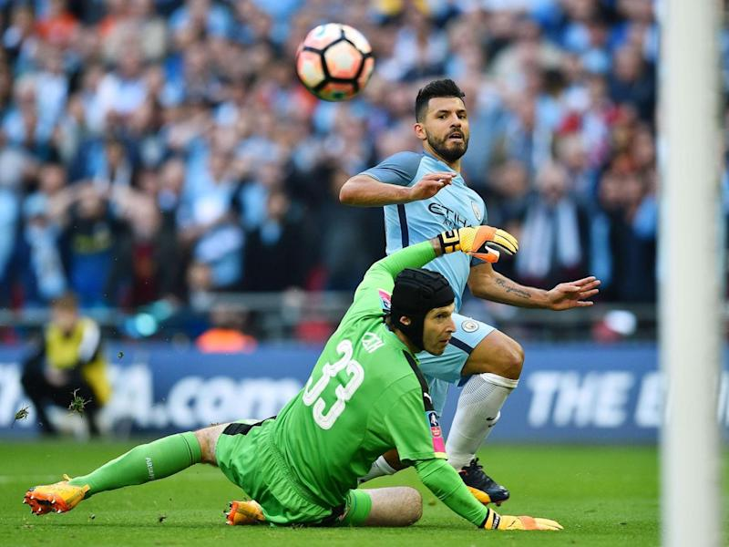 Sergio Aguero chips the ball over Petr Cech to score for Manchester City (Getty)