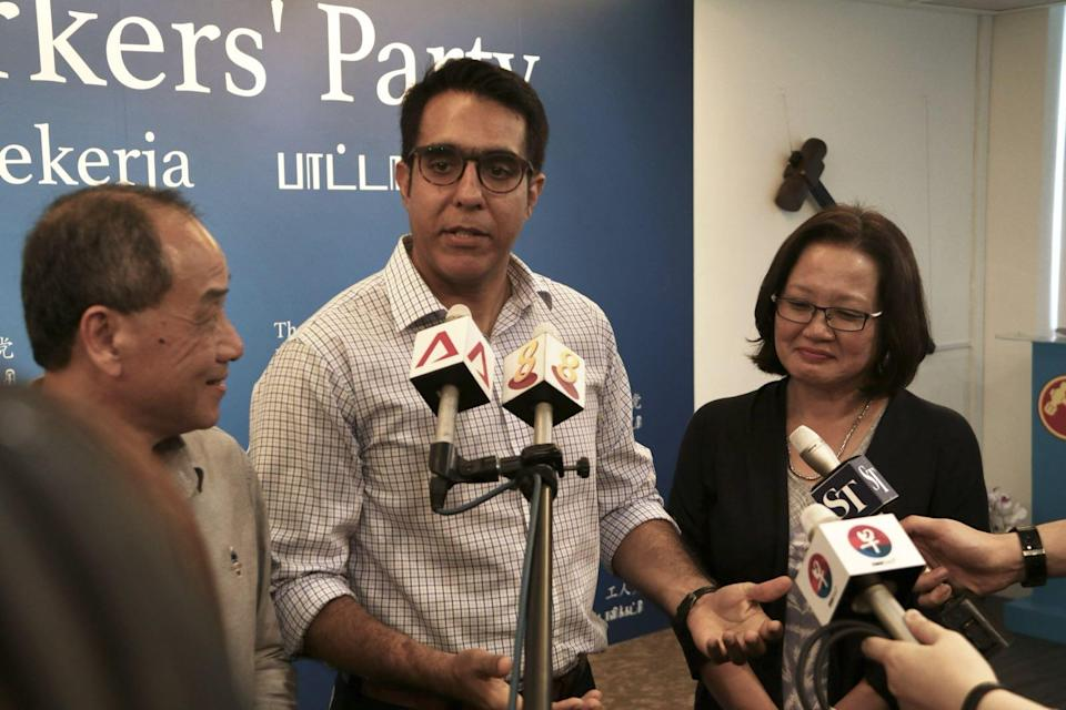 Pritam Singh addressing the media following the Workers' Party elections for its new central executive council on Sunday (8 April). With him are former WP chief Low Thia Khiang (left) and WP chairman Sylvia Lim. (PHOTO: Dhany Osman / Yahoo News Singapore)