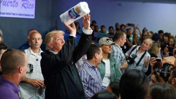 PHOTO: President Donald Trump tosses paper towels into a crowd as he hands out supplies at Calvary Chapel, Oct. 3, 2017, in Guaynabo, Puerto Rico. (Evan Vucci/AP)