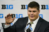 Iowa center Tyler Linderbaum talks to reporters during an NCAA college football news conference at the Big Ten Conference media days, at Lucas Oil Stadium in Indianapolis, Friday, July 23, 2021. (AP Photo/Michael Conroy)