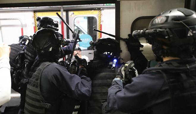 Riot police storm into a train to chase protesters at Prince Edward station on August 31. Photo: Handout