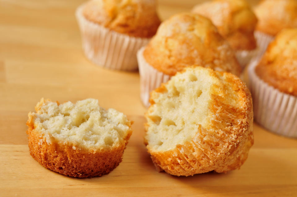 closeup of some magdalenas, typical spanish plain muffins, on a wooden table