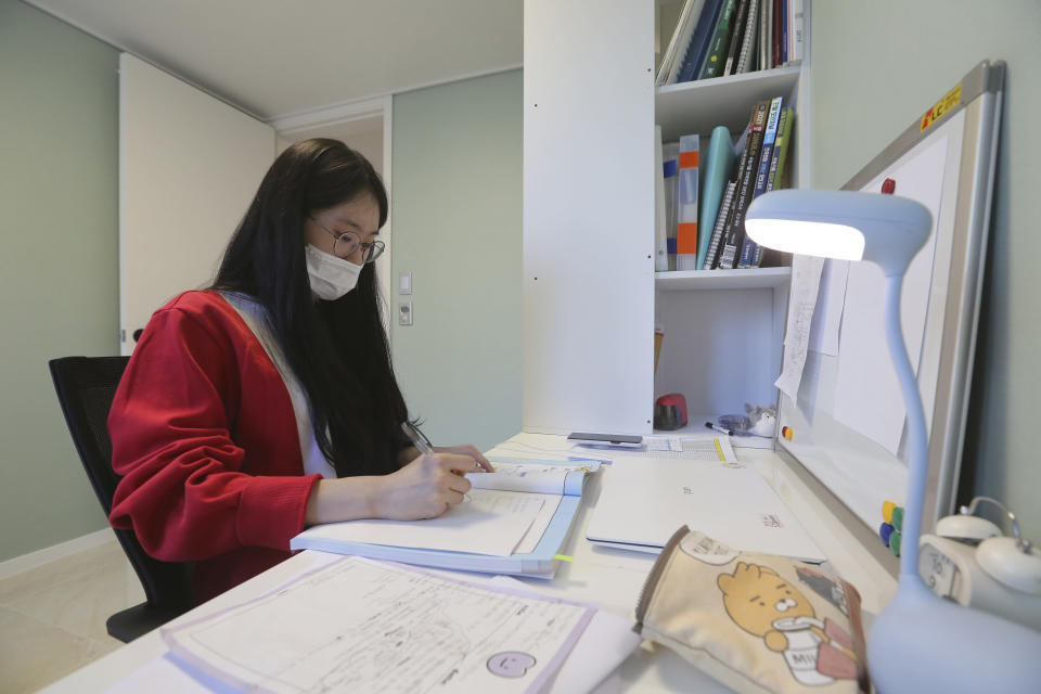 "Ma Seo-bin, a high school senior at an elite, , expensive foreign language school near Seoul, studies at her home in Siheung, South Korea, on Sept. 19, 2020. ""I felt I was trapped at the same place and I got lots of psychological stress,"" said Ma. When South Korea began its delayed school year with remote learning in April, that spelled trouble for low-income students who rely on public education, get easily distracted and cannot afford private schools or tutors used by many in this education-obsessed country. (AP Photo/Ahn Young-joon)"
