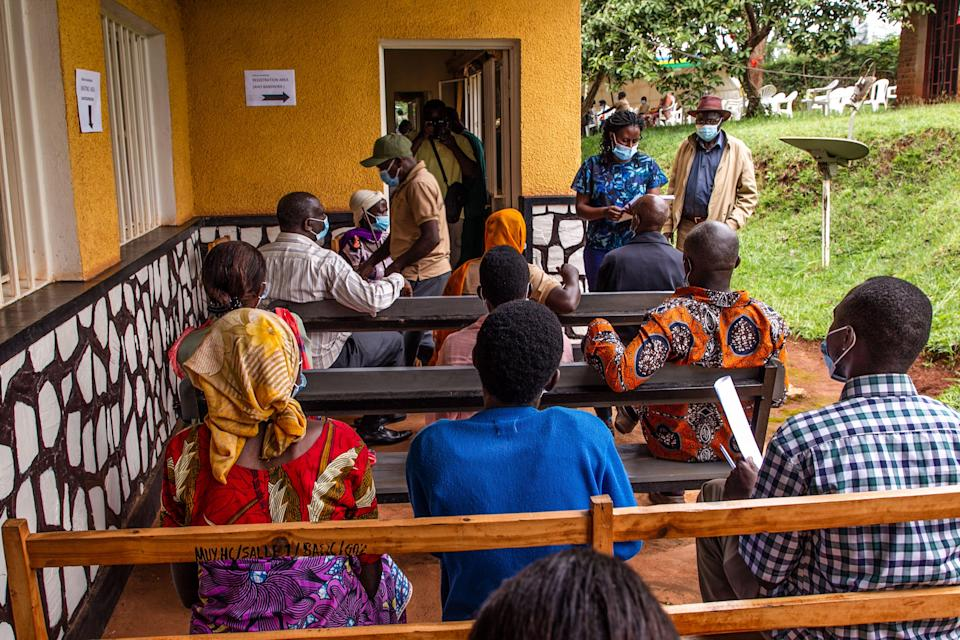Elderly people wait for their first injection of  Covid-19 vaccine at Muyumbu Health Center in Rwamagana, East Kigali (AFP via Getty Images)