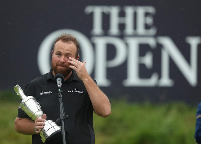 Ireland's Shane Lowry wipes away a tear as he makes a speech holding the Claret Jug trophy after winning the British Open Golf Championships at Royal Portrush in Northern Ireland, Sunday, July 21, 2019.(AP Photo/Jon Super)