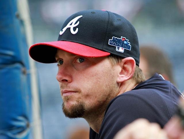 Atlanta Braves third baseman Chris Johnson watches a teammate in batting practice Wednesday, Oct. 2, 2013, in Atlanta. The Braves are scheduled to play the Los Angeles Dodgers in Game 1 of baseball's NL division series on Thursday. (AP Photo/Atlanta Journal Constitution, Jason Getz)