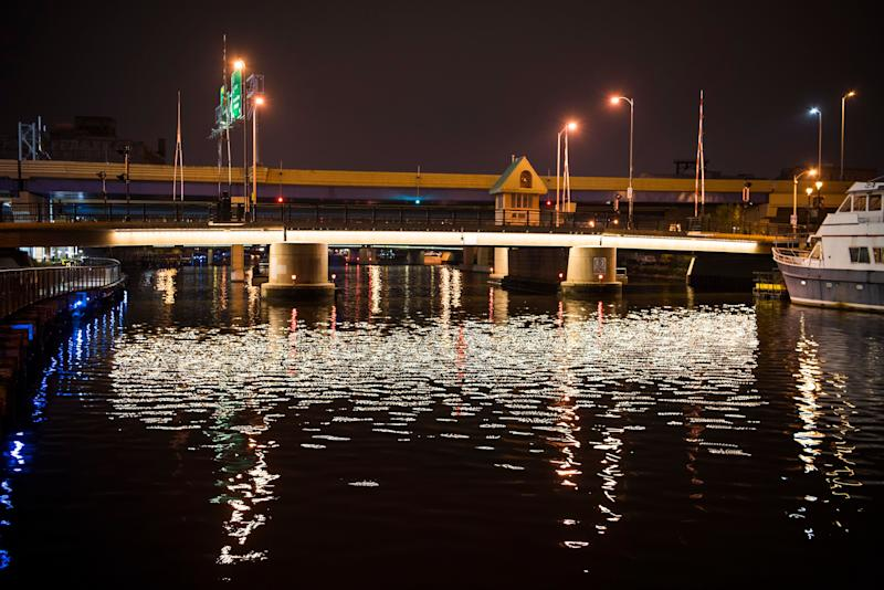 A bridge is reflected in the Milwaukee River, which runs through the city's downtown.