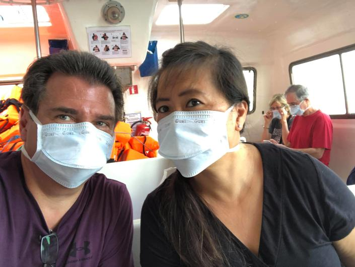 Rick and Wendy de Pinho, passengers aboard the virus-stricken Zaandam cruise ship, while they transferred to the Rotterdam cruise ship on Sunday. | Courtesy of Rick and Wendy de Pinho