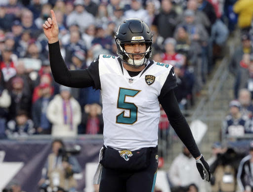 FILE - In this Sunday, Jan. 21, 2018 file photo, Jacksonville Jaguars quarterback Blake Bortles celebrates a touchdown run by running back Leonard Fournette during the first half of the AFC championship NFL football game against the New England Patriots in Foxborough, Mass. Jacksonville Jaguars quarterback Blake Bortles had quite the start to his offseason. He had wrist surgery. He signed a $54 million contract. And he nearly got robbed. (AP Photo/Steven Senne, File)