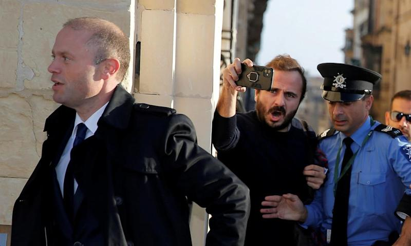 Malta's prime minister Joseph Muscat arrives at his office before a meeting with members of the European parliament on 3 December.