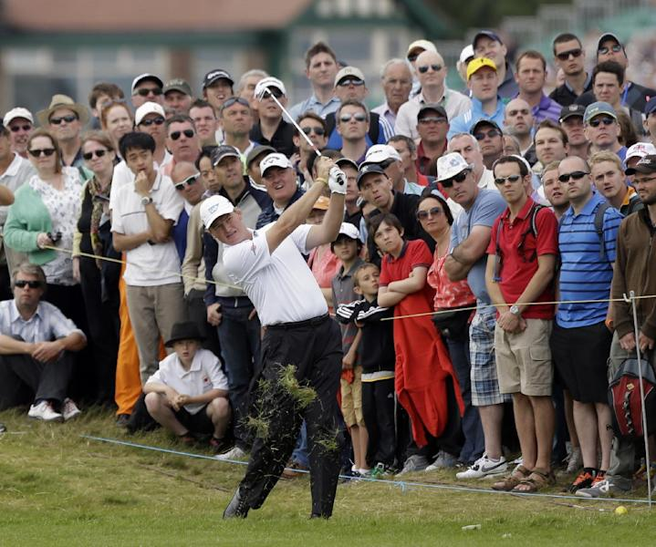 Ernie Els of South Africa plays a shot on the third fairway at Royal Lytham & St Annes golf club during the final round of the British Open Golf Championship, Lytham St Annes, England Sunday, July 22, 2012. (AP Photo/Peter Morrison)