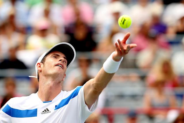 MONTREAL, QC - AUGUST 07: Andy Murray of Great Britain returns a shot to Marcel Granollers of Spain during the Rogers Cup at Uniprix Stadium on August 7, 2013 in Montreal, Quebec, Canada. (Photo by Matthew Stockman/Getty Images)