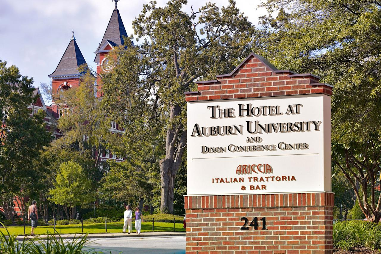 """<p>Located on campus and owned by the university, The Hotel at Auburn University is the front door to campus. You'll have a front row to all pre-and-post-game activities that the city has to offer as it's just a short walk to Jordan-Hare Stadium and one block from Toomer's Corner. </p> <p><strong>Book It: <em><a href=""""https://www.auhcc.com"""" target=""""_blank"""">auhcc.com</a></em></strong></p>"""