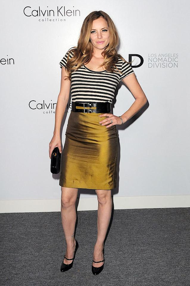 """Actress/model Bijou Phillips impressed in a bold, sleek skirt and chic accessories, including the ring we suspect she received from her funny guy fiance, Danny Masterson of """"That '70s Show."""" Jordan Strauss/<a href=""""http://www.wireimage.com"""" target=""""new"""">WireImage.com</a> - January 28, 2010"""
