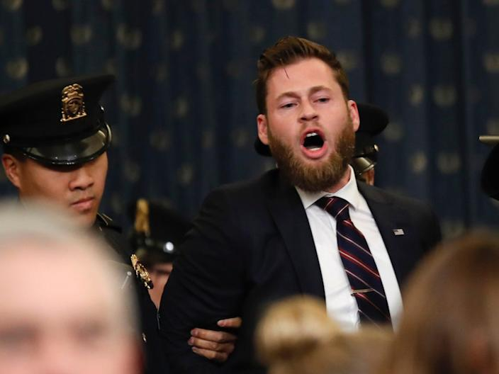 A protester is removed from the hearing room as the House Judiciary Committee hears investigative findings in the impeachment inquiry of President Donald Trump, Monday, Dec. 9.
