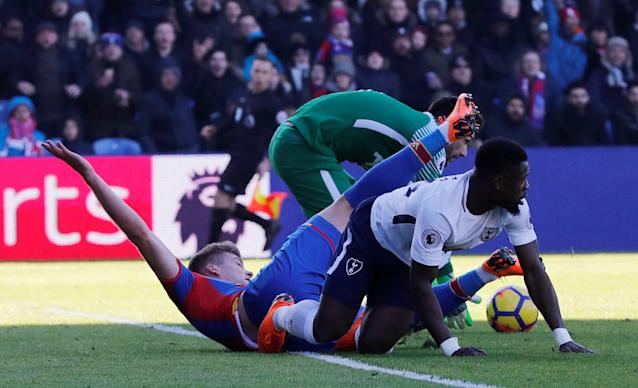 "Soccer Football - Premier League - Crystal Palace vs Tottenham Hotspur - Selhurst Park, London, Britain - February 25, 2018 Crystal Palace's Alexander Sorloth is challenged by Tottenham's Serge Aurier REUTERS/Eddie Keogh EDITORIAL USE ONLY. No use with unauthorized audio, video, data, fixture lists, club/league logos or ""live"" services. Online in-match use limited to 75 images, no video emulation. No use in betting, games or single club/league/player publications. Please contact your account representative for further details."