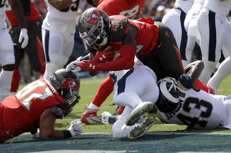 Tampa Bay Buccaneers running back Peyton Barber scores against the Los Angeles Rams during the first of an NFL football game Sunday, Sept. 29, 2019, in Los Angeles. (AP Photo/Marcio Jose Sanchez)