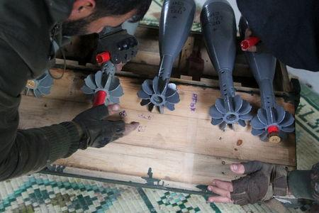 Free Syrian Army fighters prepare shells before firing them towards Islamic State fighters in the northern Aleppo countryside, Syria