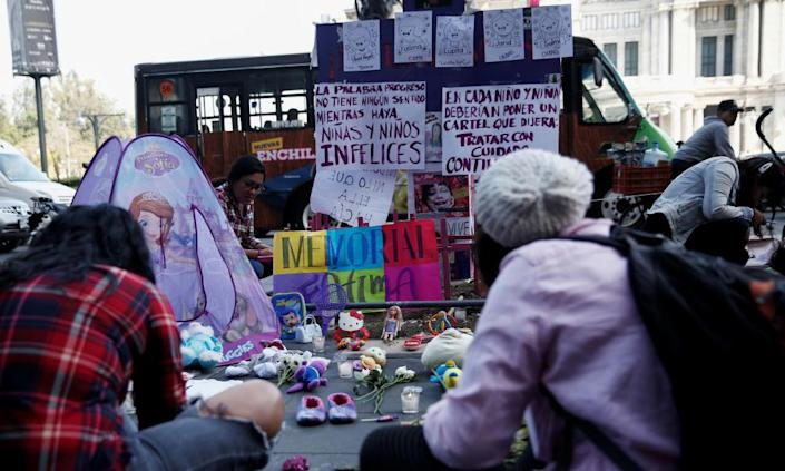 """<span class=""""element-image__caption"""">People gather in memory of seven-year-old Fátima Aldrighetti Antón at an anti-femicide monument in Mexico City, Mexico, on Wednesday.</span> <span class=""""element-image__credit"""">Photograph: Carlos Jasso/Reuters</span>"""