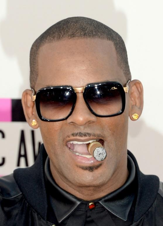 R. Kelly, shown here at the 2013 American Music Awards, for years acted with impunity despite serious sex abuse allegations against him, prosecutors say (AFP/Jason Kempin)