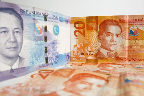 FILE PHOTO: Manuel A. Roxas, left, and Manuel L. Quezon, former presidents of the Philippines, are displayed on a one hundred, left, and twenty peso banknotes respectively. (Photo: Getty Images)